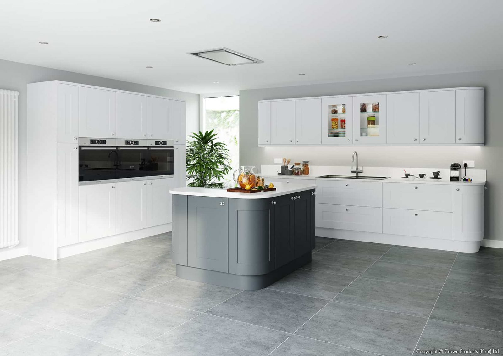 L shape open plan kitchen with a small island shown in Avio white and graphite