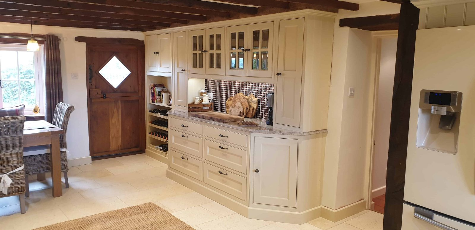 a traditional country style handmade in frame kitchen in a custom cream paint