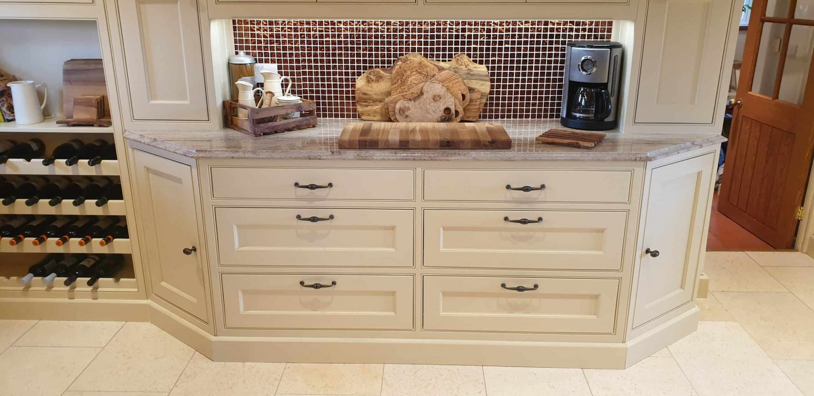 A detailed photo of a handmade inframe shaker kitchen dresser with wine storage