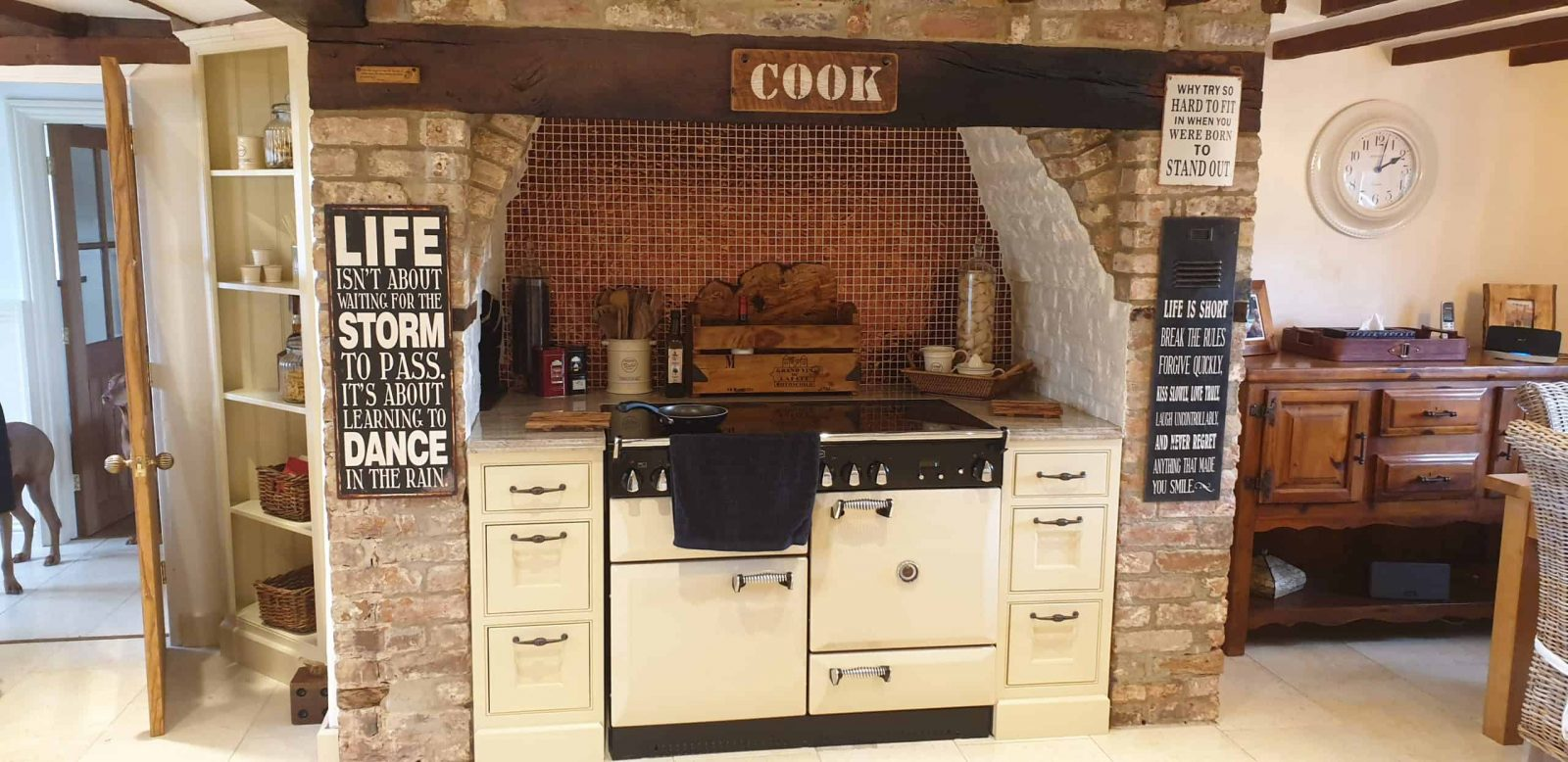 A handmade shaker kitchen showing a range cooker built into a chimney breast